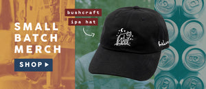 Picture of black hat with embroidered wolf.  Small Batch Merch.  Click to Shop.