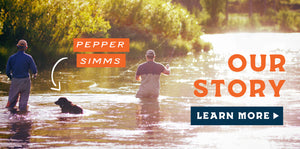 Picture of 2 men fly fishing with a black lab named Pepper Simms.  Our Story.  Click to learn more.