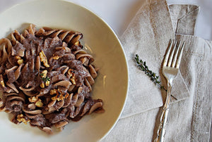 Eliche Pasta with creamy Red chicory sauce and roasted walnuts