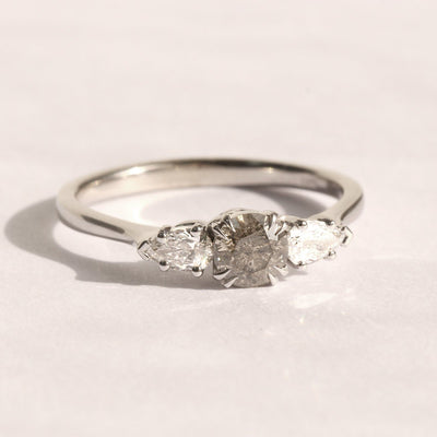 white gold ring set with gray diamond
