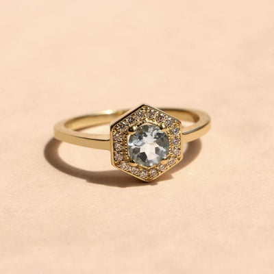 halo ring with aquamarine and diamonds
