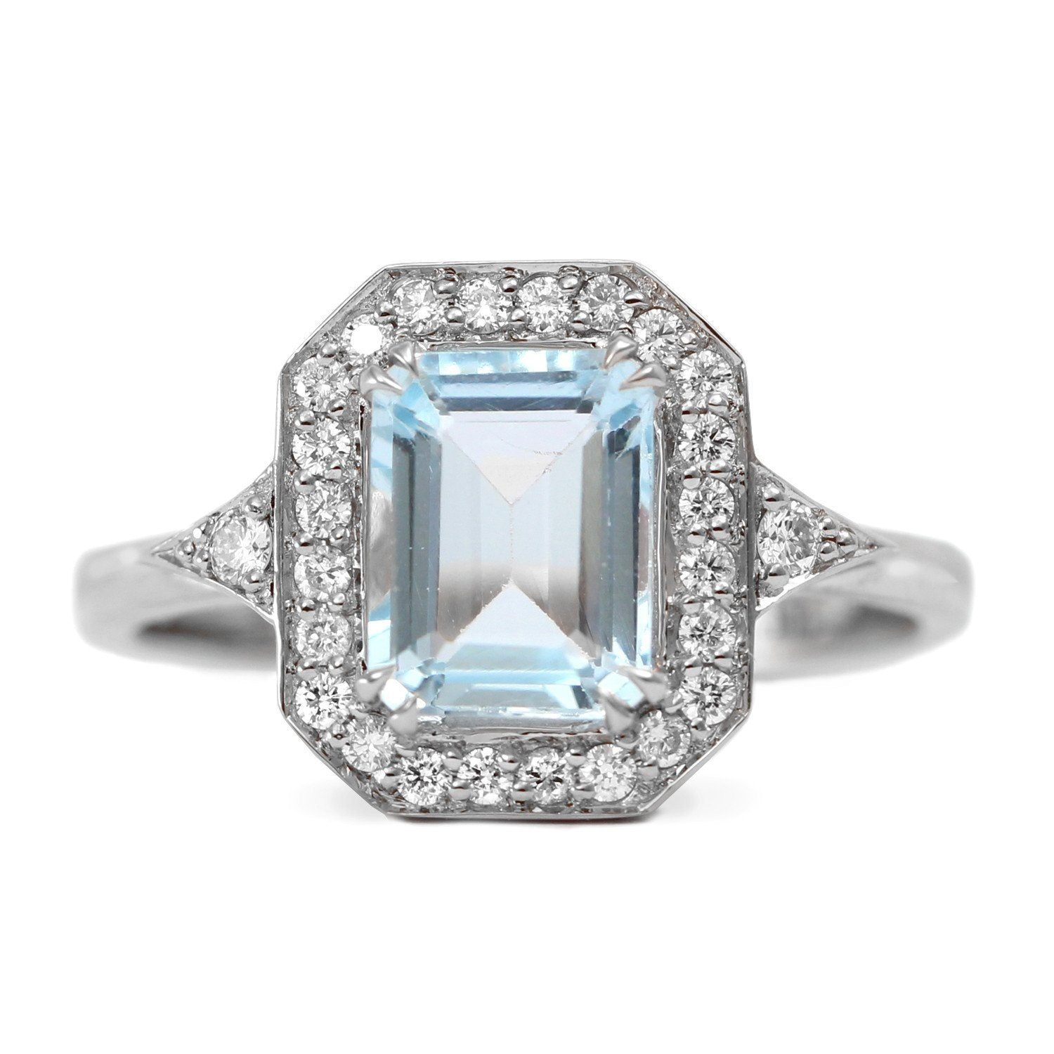 white gold halo ring with large aquamarine