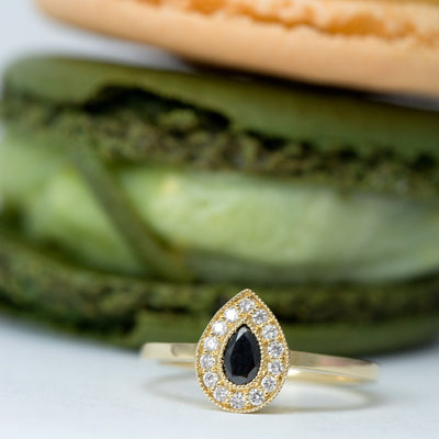 pear black diamond on a gold ring