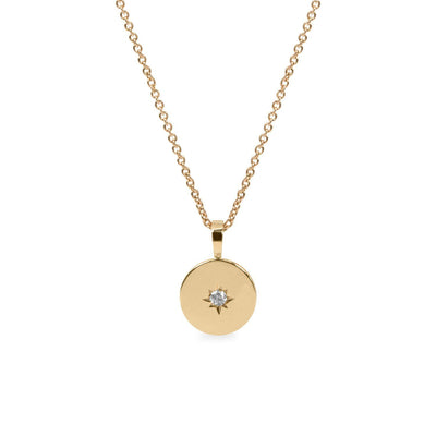 gold necklace with engraved letter and diamond