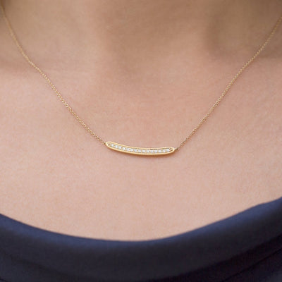 gold necklace set with 15 diamonds