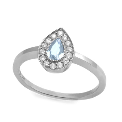 aquamarine and diamonds on a white gold ring