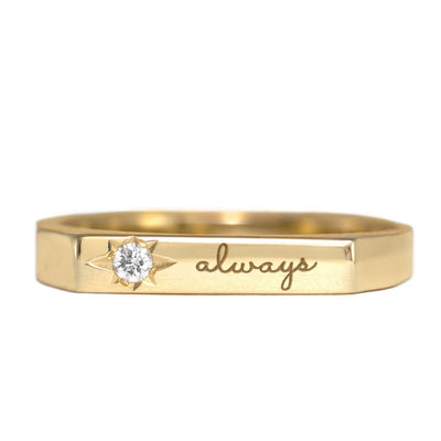 gold engraved ring with diamond