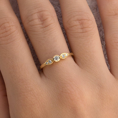 engagement ring with five diamonds