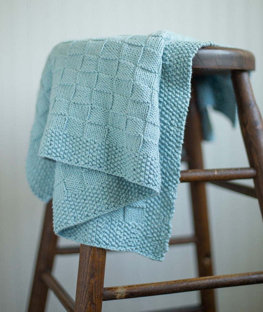 Seed stitch knit borders and basket weave knitting pattern for blanket.