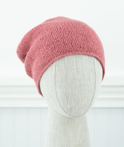 Dusty Pink slouchy hat on head form facing camera.
