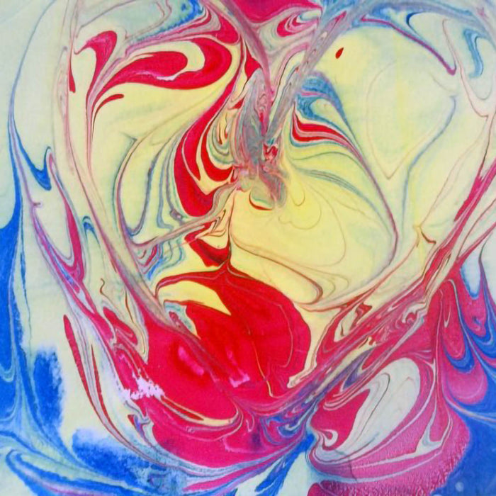 Pebeo marbling ink - close up of the swirling patterns created in red yellow and blue