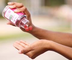 Vitamins being poured into hands