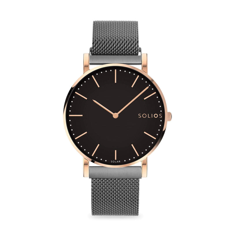 Solios Eclipse, sustainable and solar watch with a black dial and a rose gold stainless steel case, made by a Canadian company, with a grey stainless steel mesh eco leather strap with magnetic clasp