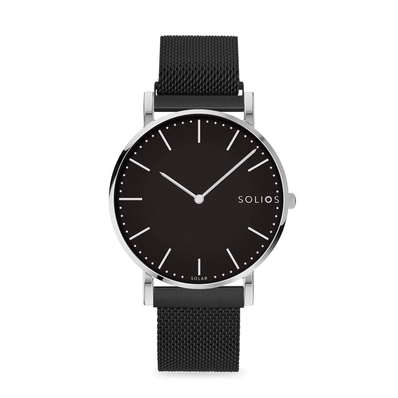Solios Lux, sustainable and solar watch with a black dial and a silver stainless steel case, made by a Canadian company, with a black stainless steel mesh eco leather strap with magnetic clasp