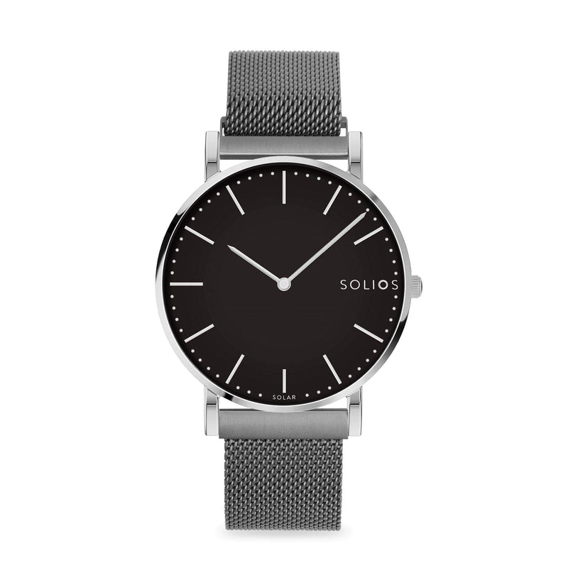 Solios Lux, sustainable and solar watch with a black dial and a silver stainless steel case, made by a Canadian company, with a grey stainless steel mesh eco leather strap with magnetic clasp