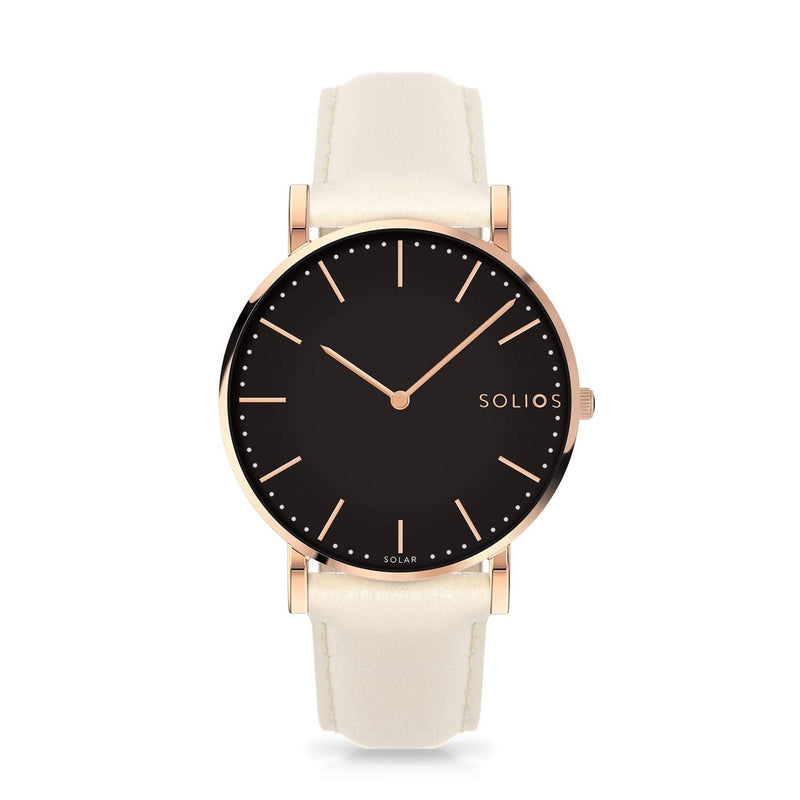 Solios Eclipse, sustainable and solar watch with a black dial and a rose gold stainless steel case, made by a Canadian company, with a cream vegan eco leather strap