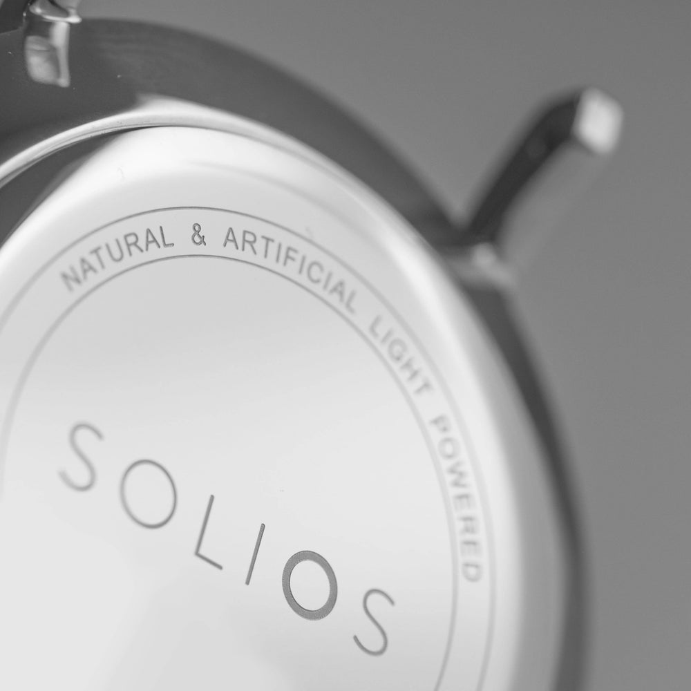 The Logo and Natural & Artificial light powered feature engraved on the back case of the Solios watch.