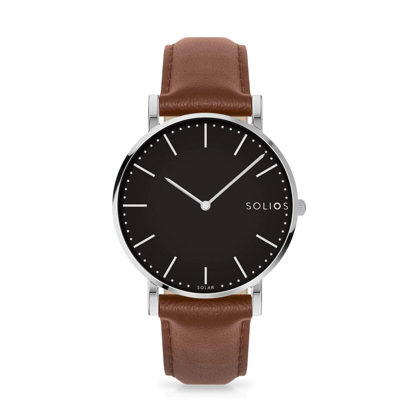 Solios Lux, sustainable and solar watch with a black dial and a silver stainless steel case, made by a Canadian company, with a brown vegan eco leather strap