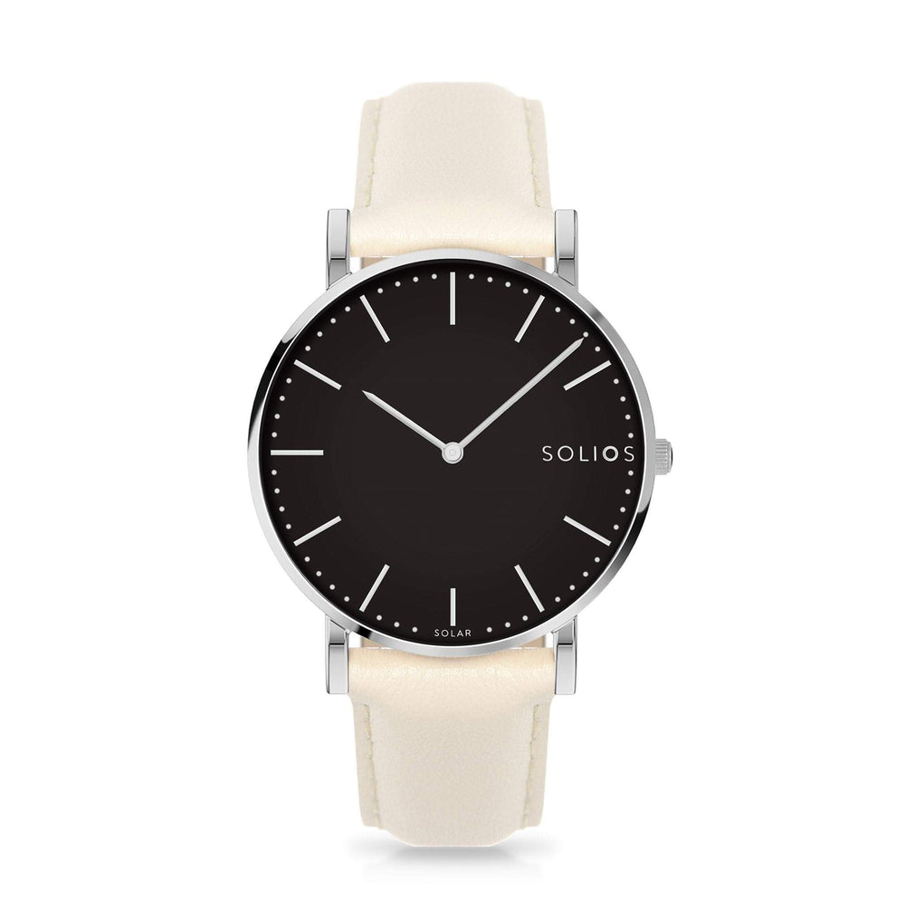 Solios Lux, sustainable and solar watch with a black dial and a silver stainless steel case, made by a Canadian company, with a cream vegan eco leather strap
