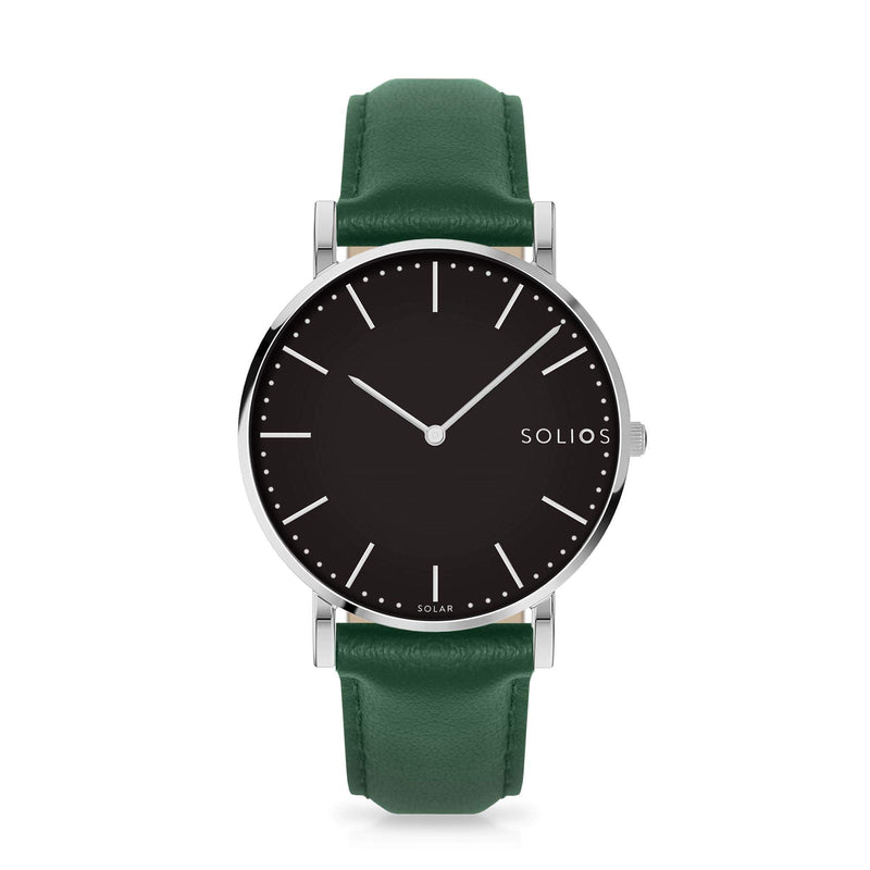 Solios Lux, sustainable and solar watch with a black dial and a silver stainless steel case, made by a Canadian company, with a green vegan eco leather strap