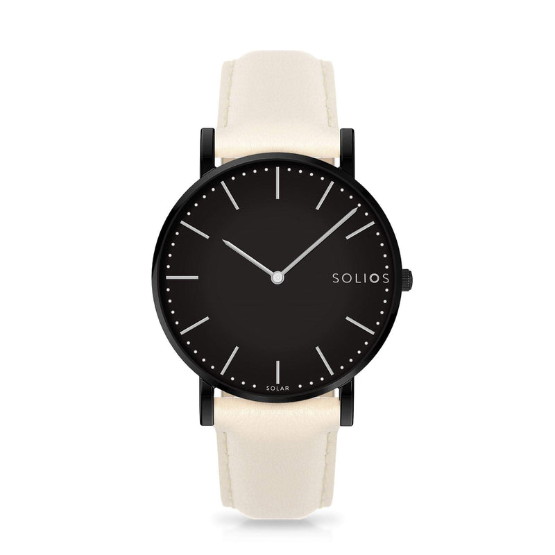 Solios Nebula, sustainable and solar watch with a black dial and a black stainless steel case, made by a Canadian company, with a cream vegan eco leather strap