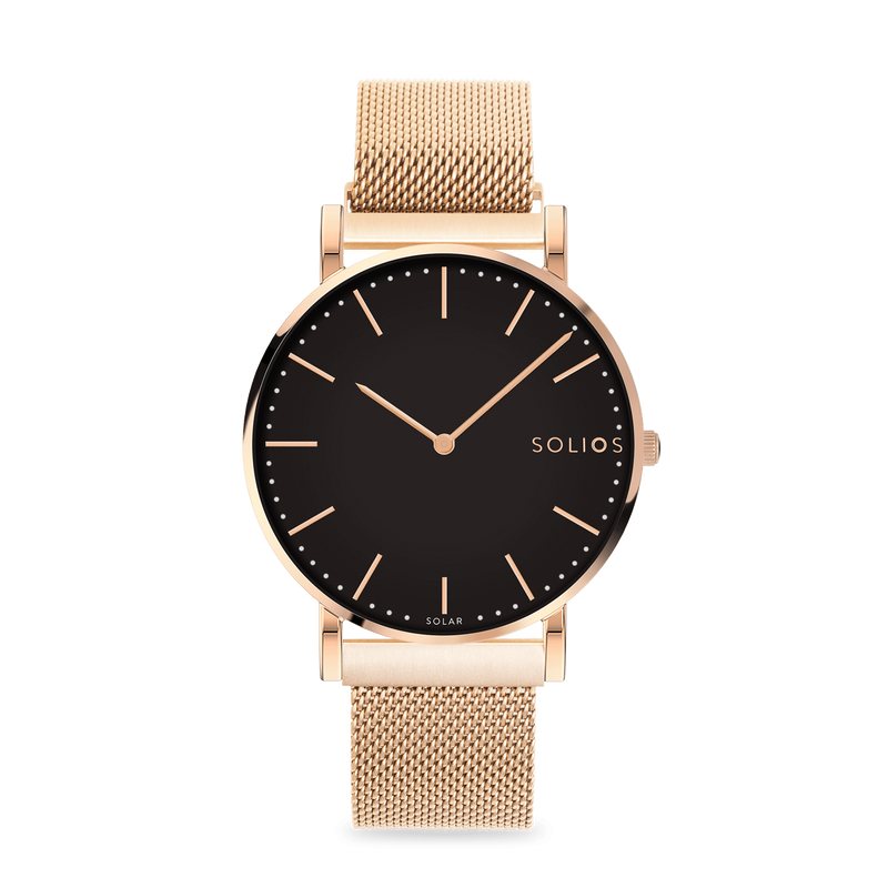 Solios Eclipse, sustainable and solar watch with a black dial and a rose gold stainless steel case, made by a Canadian company, with a rose gold stainless steel mesh eco leather strap with magnetic clasp
