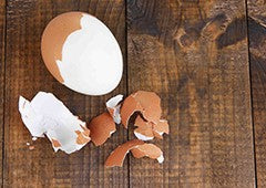 Boiled egg peeled on kitchen table