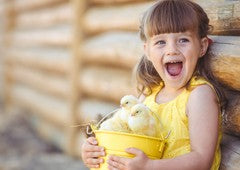 Little girl happy about baby chickens