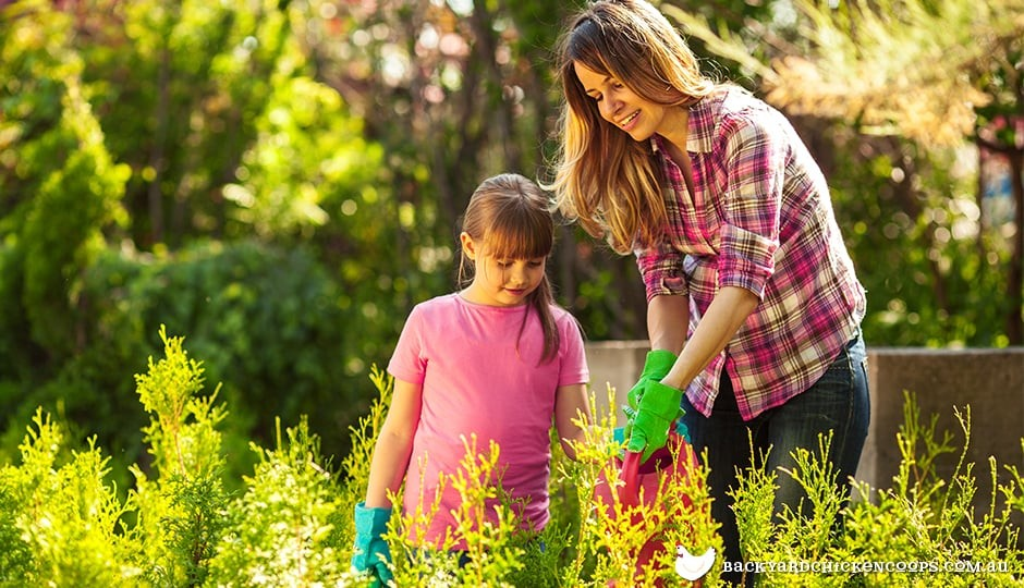 mother-and-daughter-gardening-together