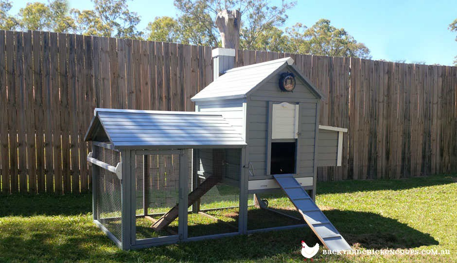 Taj Mahal backyard chicken coop painted grey and white