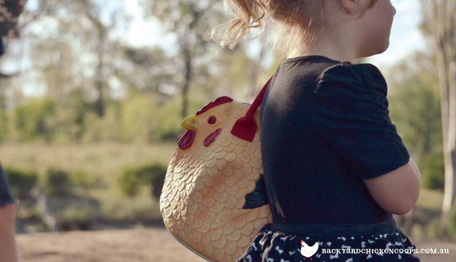Young girl with chicken bag
