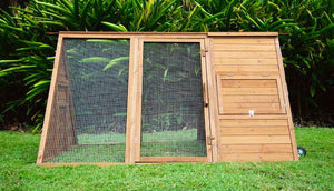 cluck house chicken coop with all doors closed