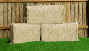 three bales of hemp bedding for chicken coop