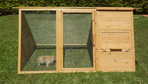 front view of hoppy hotel hutch with rabbit inside