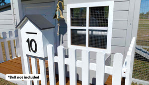 close up of letter box and picket fence on bed and breakfast chicken coop