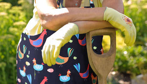 close up of woman wearing chicken apron outdoors