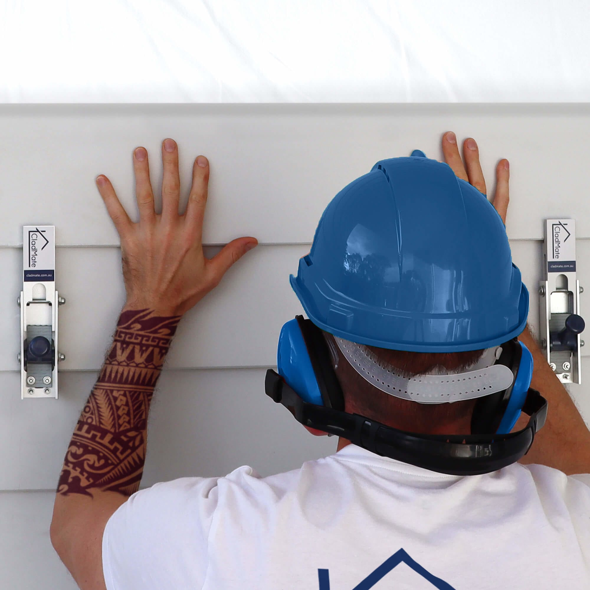 Carpenter Using CladMate Weatherboard Clamps