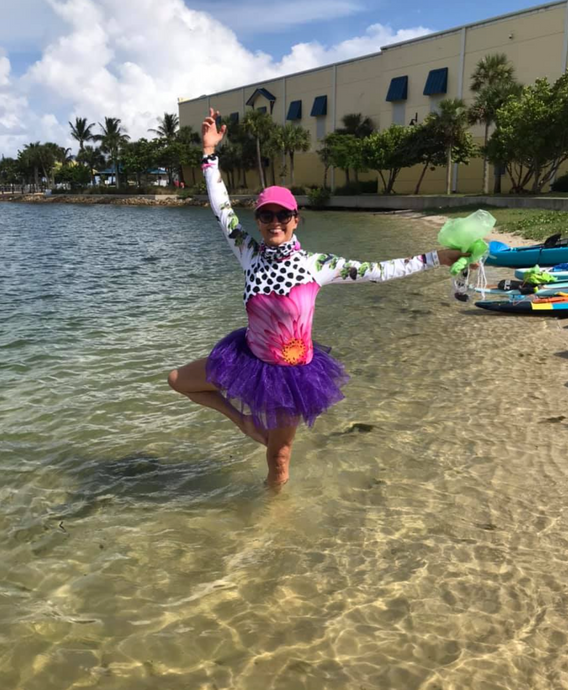 Check out Marcella in her adorable surreal UPF top and purple tutu!