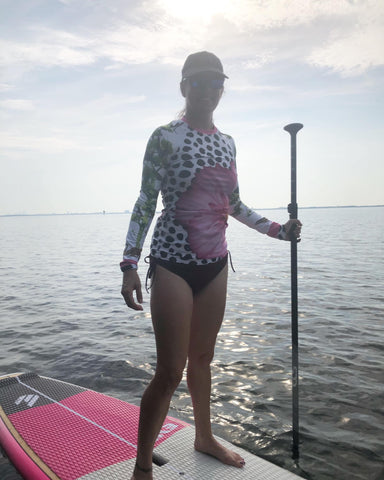 Charlotte in her Crazy Tree Rash Guard