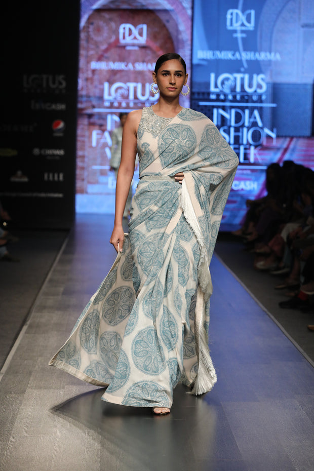 A Printed Fringe Saree With An Embellished Blouse & Belt