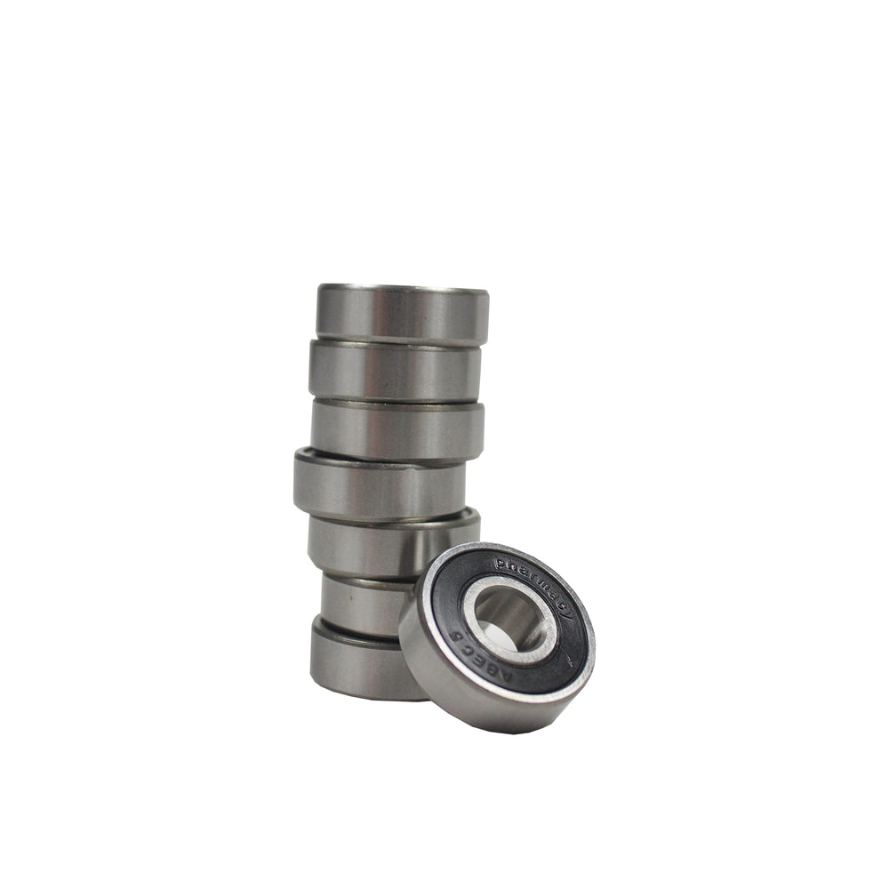 Set of eight steel wheel bearings.