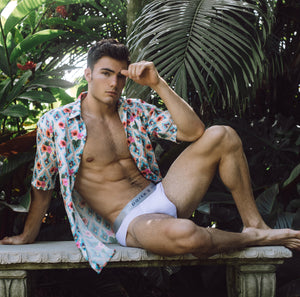 Parke & Ronen Spring 2020 Male Model in Hamsa Print Satin Shirt and Solid White Underwear Brief
