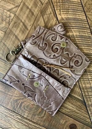 LV Jordan Tooled Leather Wristlet