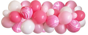 Rose pink, blush pink, white and pink and white marble balloons strung along decorating strip to create balloon garland/arch