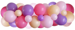 Pink, purple, blush pink balloons strung along decorating strip to create balloon garland/arch