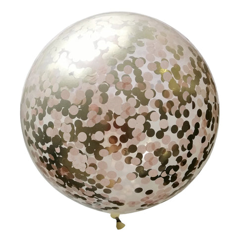 Blush light pink round confetti inside a giant clear balloon