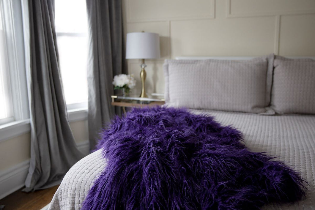 grape purple long faux fur bedroom blanket or throw for upscale decor