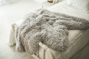 light gray long soft faux fur home decor throw with pillows for bedroom or living room. American made by FuRmanity