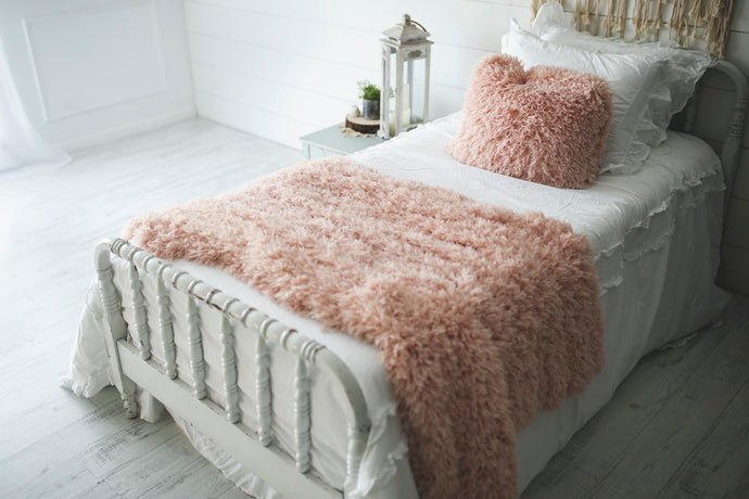 soft peach, faux fur, girl's bedroom blanket on bed