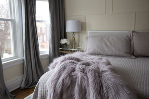 light purple faux fur bedroom blanket for sexy or sensual bedroom decor
